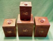 Set of (4) vintage nesting CANISTER set w/ EAGLE BADGE & cross hatch carving.VGC