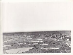 IWM Press Photo WW1 a devastated battlefield with graves Unknown and undated