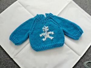 Hand knitted blue jumper for teddy bear