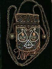 Intricated beaded amulet drawstring bag.