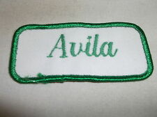 AVILA  USED EMBROIDERED VINTAGE SEW ON NAME PATCH TAG GREEN ON WHITE