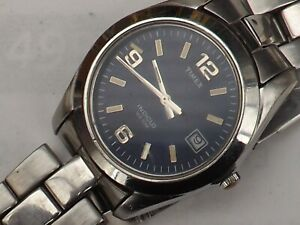 a vintage gents blue dialled timex quartz watch GWO