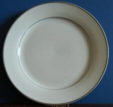 A 10.5 inch / 27 cm porcelain dinner plate with gilt rim by Whitakers Porcelain