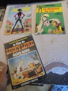 Albums Souples Lucky Luke Lot de 3 Phil Defer,Daisy Town & Bataille du Riz Total