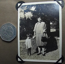 Vintage 1920s photograph Small girl with woman wearing pleated skirt and shawl
