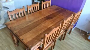 Solid sheesham/Indian rosewood dining table and 6 matching chairs - used