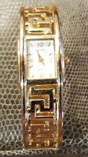 Gruen women's vintage gold color clasp band watch