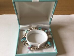 Love Links Silver Charm Bracelet ,With 18 Silver Charms .in original Box.