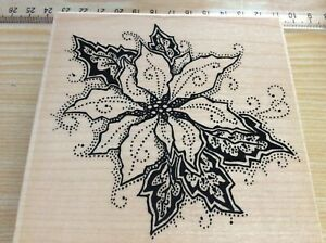 """Stampendous w/m Rubber stamp. Poinsettia points. About 4"""" square."""