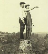 "VINTAGE PHOTO: MAN and TEEN BOY in CAPS on TREE STUMP Boy POINTING ""OVER THERE"""