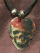 PIRATES of the CARIBBEAN Guitar Pick Necklace SKULL DISNEY 3D Motion
