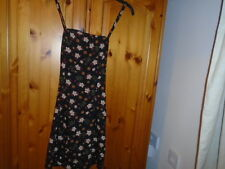 Black and brown floral hip length summer top, crossover straps at the back, 8-10