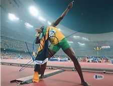 USAIN BOLT SIGNED 8X10 PHOTOGRAPH BECKETT BAS CERTIFIED AUTOGRAPH B48501