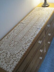 """A NOTTINGHAM LACE COTTON TABLE RUNNER.  CREAM COLOUR,  15""""  x  54""""  APPROX."""