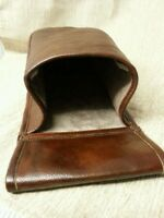 Brown real leather  Cartridge pouch holds a box of 25. 12g shotgun cartridges