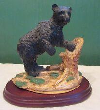 Black Bear Figurine With Tree Stump On Wooden Base