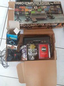 Atari 2600 Video Game Console in Original Box with ~100 Game Cartridges