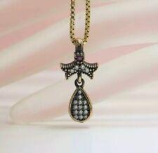 .20ctw Diamond Cut White Sapphire, Ruby 14kYellow Gold &Sterling Silver Pendant