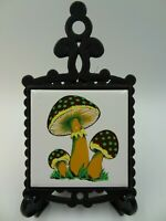 VINTAGE COLLECTIBLE  MADE IN JAPAN TRIVET OR WALL ART CAST IRON WITH TILE CENTER