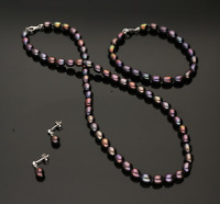 CULTURED PEARL NECKLACE, BRACELET & EARRING SET BLACK WITH PURPLE HUE COLOUR.