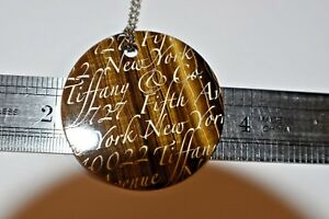 """Tiffany & Co Tiger Eye Fifth Ave. Notes Larage Round Pendant Necklace 17"""""""