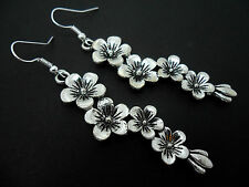 A PAIR OF LONG DANGLY TIBETAN SILVER FLOWER  EARRINGS. NEW.
