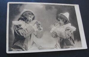 Vintage 1910 postcard 'Tit For Tat'.