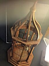 Chinese Wood And Metal Bird Cage. With A Bird And Porcelain Feeders