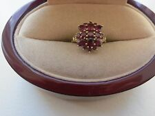 SIGNED STS  10K YELLOW GOLD RING  WITH GARNET STONES