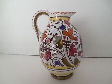 Small hand painted ceramic pitcher from Italy