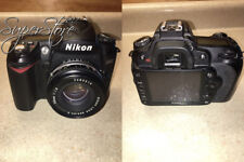 Nikon D90 12.3MP DX-Format CMOS Digital SLR Camera with 18-105 mm f/3.5-5.6G...