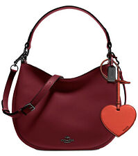 COACH burgundy Nomad Glovetanned Leather Crossbody  heart bag charm