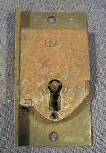 Old brass furniture lock.