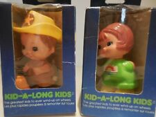 KID A LONG KIDS  ROLLER SKATER AND RIDES A PONY   TOMY   PARKER MADE IN TAIWAN