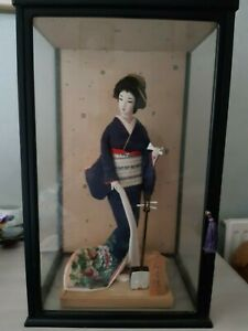 Japanese Geisha Girl Doll in glass and wood case.  Case is 21inches tall.