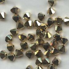 T6 5301  DD *** 15 toupies cristal Swarovski 6 mm CRYSTAL AURUM 2X