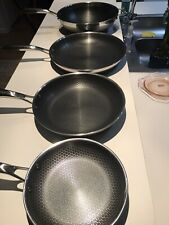 Hexclas 4 Piece Pans With Signs Of Used ,Scratches 8' ,10' ,12w and12' No Lids