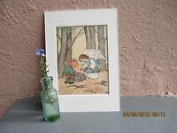 vintage Ida Bohatta-Morpurgo illustration of angel helping child gather wood1933