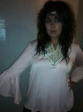 Soft pink bell sleeved blouse