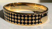 HALCYON DAYS HOUDON BLACK AND GOLD HINGED BANGLE WITH BLACK VELVET POUCH. NEW