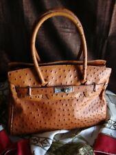 sac porté main en cuir d'autruche