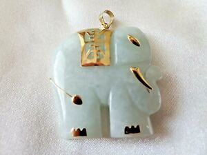 Jade stone caved elephant gold accents bail 14k/585 carved to depict Ganesha ?
