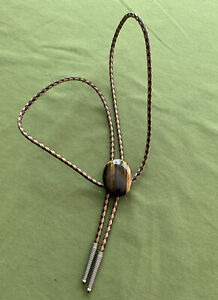 VINTAGE POLISHED STONE AND LEATHER BOLO TIE