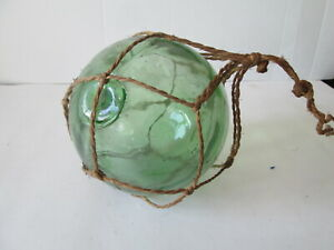 Glass fishing float. Nautical collectables.Marine collectables. Marine antiques