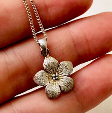 Silver and diamond flower pendant with silver chain