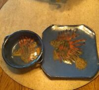 Clay Pottery, Blue Glazed With a Dragon Or Lion Fish Square Plate & Round Bowl