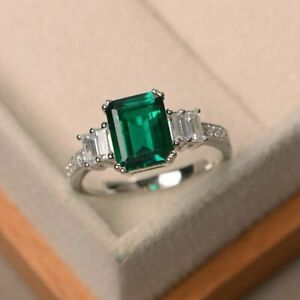 9 x 7 mm Emerald & Diamond Side Stone Engagement Ring 14K White Gold Finish