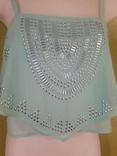 Bebe top in size xxs a light turquoise blue stones on metallic blue as well