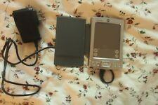 Palm Tungsten E Hand Held Organizer has stylus,adapter and charger.