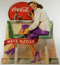 COCA COLA HAVE A COKE LADY SITS ON JADITE DINER BAR STOOL HEAVY DUTY METAL SIGN